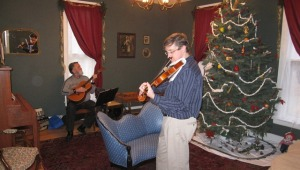 Any time of the year finds interesting activities....Here is a fiddler at Christmas in the parlor.